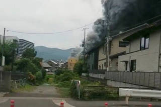 Social media video grab of smoke billowing from a fire at the Kyoto Animation studio in Kyoto