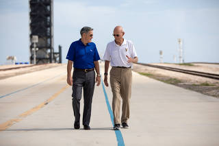 Astronaut Michael Collins speaks with NASA's John F. Kennedy Space Center Director Bob Cabana at Launch Pad 39A at the NASA's John F. Kennedy Space Center on the 50th anniversary of the launch of the Apollo 11 mission to the moon, in Cape Canaveral