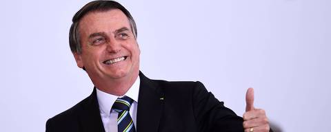 Brazilian President Jair Bolsonaro gives the thumb up during a ceremony to commemorate the first 200 days of his administration at Planalto Palace in Brasilia, on July 18, 2019. - Bolsonaro signed a membership application for the Organisation for Economic Co-operation and Development (OECD) during the ceremony. (Photo by EVARISTO SA / AFP) ORG XMIT: ESA684