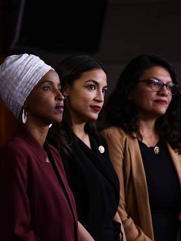 TOPSHOT - US Representatives Ayanna Pressley (D-MA) speaks as, Ilhan Abdullahi Omar (D-MN)(L), Rashida Tlaib (D-MI) (2R), and Alexandria Ocasio-Cortez (D-NY) hold a press conference, to address remarks made by US President Donald Trump earlier in the day, at the US Capitol in Washington, DC on July 15, 2019. - President Donald Trump stepped up his attacks on four progressive Democratic congresswomen, saying if they're not happy in the United States