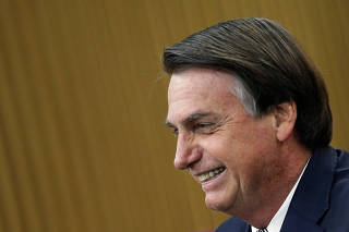 Brazil's President Jair Bolsonaro looks on during a National Soccer Day Ceremony in Brasilia