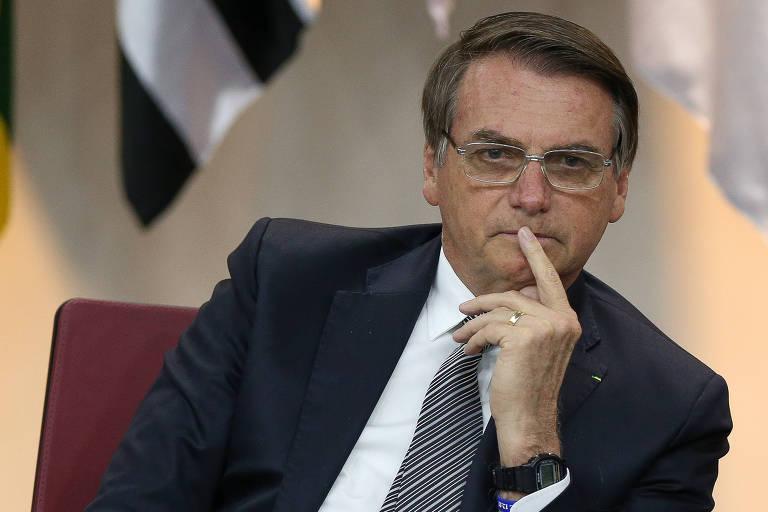 Presidente Jair Bolsonaro de óculos