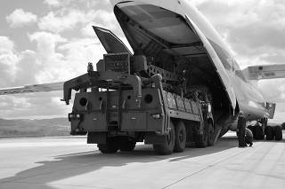 First parts of a Russian S-400 missile defense system are unloaded from a Russian plane at Murted Airport near Ankara
