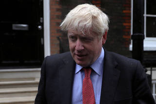 FILE PHOTO: Boris Johnson, a leadership candidate for Britain's Conservative Party, leaves offices in central in London