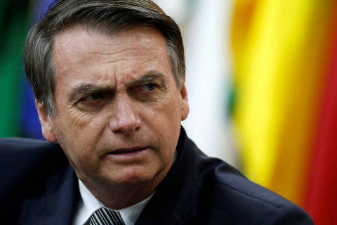 Brazil's President Jair Bolsonaro looks on during a National Soccer Day Cerenomy in Brasilia, Brazil July 19, 2019. REUTERS/Adriano Machado ORG XMIT: GGGAHM04