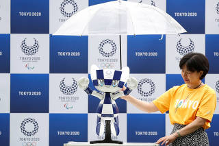 Tokyo 2020 mascot robot Miraitowa, which will be used to support the Tokyo 2020 Olympic and Paralympic Games, is unveiled during the unveiling event to celebrate the first anniversary of the mascot debut at Tokyo Stadium in Tokyo
