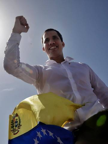 This handout picture released by Juan Guaido's photography service shows Venezuelan opposition leader and self-proclaimed interim president Juan Guaido during a rally with supporters at Los Cocos Municipal Market in Porlamar, Margarita Island, Nueva Esparta state, Venezuela, on July 19, 2019. (Photo by LEO ALVAREZ / Juan Guaido's Photography service / AFP) / RESTRICTED TO EDITORIAL USE - MANDATORY CREDIT