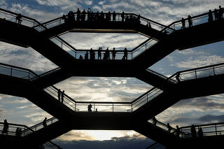 People tour the inside 'The Vessel,' a large public art sculpture made up of 155 flights of stairs at the Hudson Yards development, a residential, commercial, and retail space on Manhattan's West side in New York City