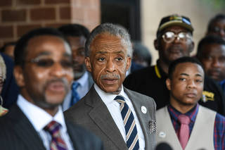 Reverend Al Sharpton from the National Action Network speaks with reporters about U.S. President Donald Trump's tweets about Baltimore in Baltimore, Maryland