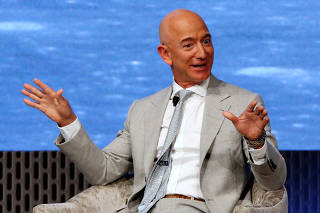 FILE PHOTO: Founder of Amazon and Blue Origin Bezos speaks at the John F. Kennedy Library in Boston