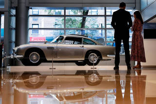 A James Bond 1965 Aston Martin DB5 coupe is displayed at Sotheby's Auction house in New York