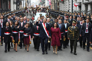 Peru's President Martin Vizcarra and his wife and first lady Maribel Cabello walk together after Vizcarra delivered his annual address in Congress, in Lima