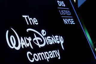 FILE PHOTO: A screen shows the trading info for the Walt Disney Company company on the floor of the NYSE in New York