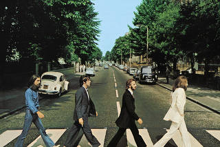 Members of the Beatles cross Abbey Road in London