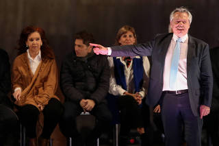 Presidential candidate Alberto Fernandez gesturs to running mate former President Cristina Fernandez de Kirchner during their closing campaign rally ahead of primary elections, in Rosario, Argentina