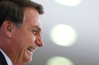 Brazil's President Jair Bolsonaro smiles during a promotion ceremony for generals of the armed forces, at the Planalto Palace in Brasilia