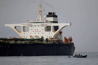 FILE PHOTO: Gibraltar defence police officers guard the Iranian oil tanker Grace 1 as it sits anchored after it was seized earlier this month by British Royal Marines in the Strait of Gibraltar