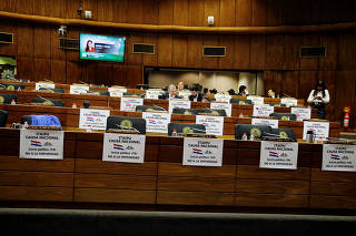 Paraguayan lawmakers sit at their desks as some continue to push to impeach President Mario Abdo and Vice President Velazquez, after Brazil and Paraguay canceled an energy deal, in Asuncion