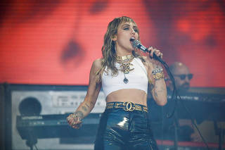 FILE PHOTO: American singer Miley Cyrus performs on the Pyramid Stage during Glastonbury Festival in Somerset