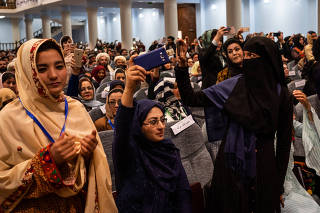 Female delegates during the opening ceremony of Afghanistan's Grand Assembly in Kabul, Afghanistan, April 29, 2019. (Jim Huylebroek/The New York Times)