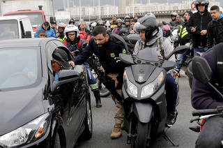 A federal police officer blocks the Rio-Niteroi Bridge, where armed police surrounded a hijacked passenger bus in Rio de Janeiro