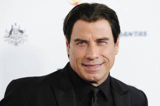 Actor Travolta arrives during the G'Day USA Black Tie Gala in Los Angeles, California