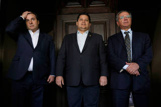 Brazil's Lower House President Rodrigo Maia, Brazil's President of the Senate Davi Alcolumbre and Brazil's Economy Minister Paulo Guedes are seen after a meeting in Brasilia