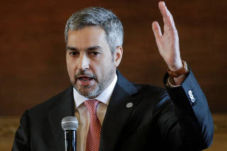 Paraguay's President Mario Abdo Benitez gestures as he makes declarations at the Lopez palace in Asuncion
