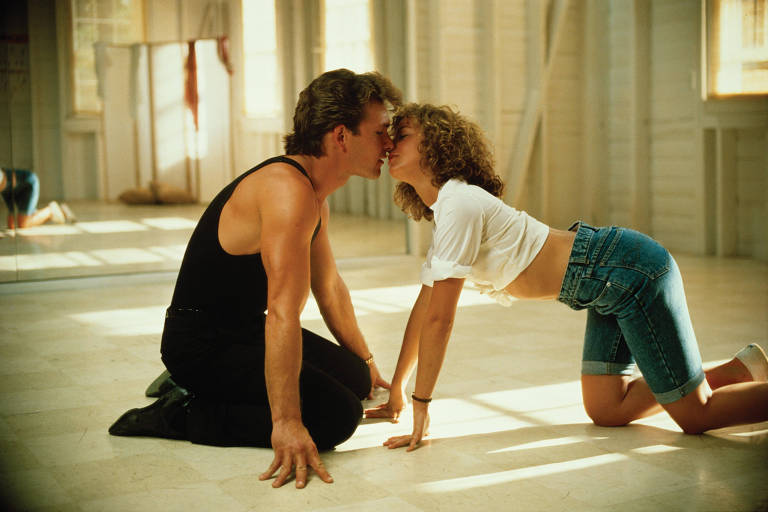 "Patrick Swayze (Johnny Castle) e Jennifer Grey (Frances ""Baby"" Houseman) em cena de ""Dirty Dancing"""