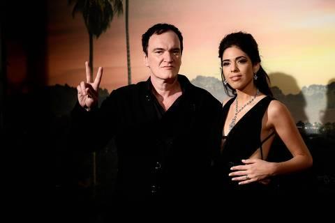 US film director Quentin Tarantino (L) and his wife Israeli singer Daniella Pick pose during a photocall ahead of the Italian Premiere of Tarantino's latest movie