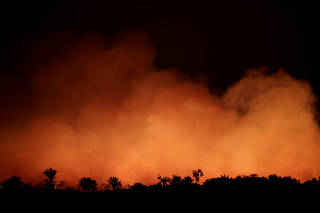 FILE PHOTO: Smoke billows during a fire in an area of the Amazon rainforest near Humaita, Amazonas