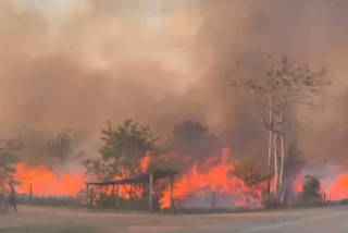 Social media video grab of fires along the BR364 highway in Guajara-Mirim, Rondonia, the northern Brazilian state near the amazon forest