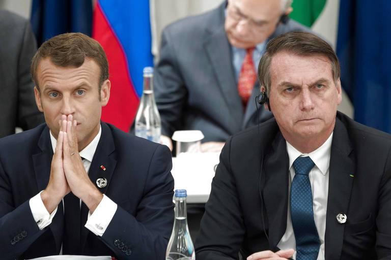 Foto de junho deste ano mostra o presidente da França, Emmanuel Macron (esq.), ao lado do brasileiro Jair Bolsonaro durante a cúpula do G20