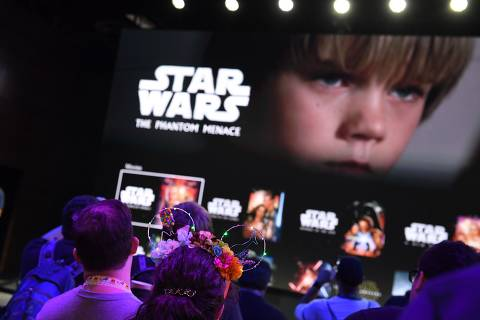 Attendees get a preview of the Disney+ streaming service interface at the D23 Expo, billed as the