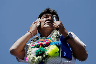 Bolivia's President Evo Morales wipes his face during a campaign rally before general elections on October 20 in La Paz