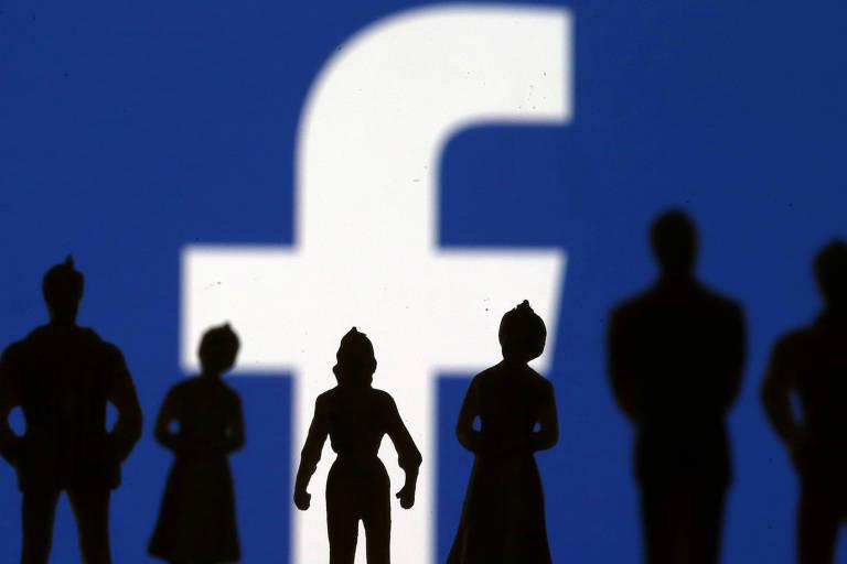 Ilustração com logotipo do Facebook; pesquisadores relatam atraso no fornecimento de dados da companhia para projetos  científicos