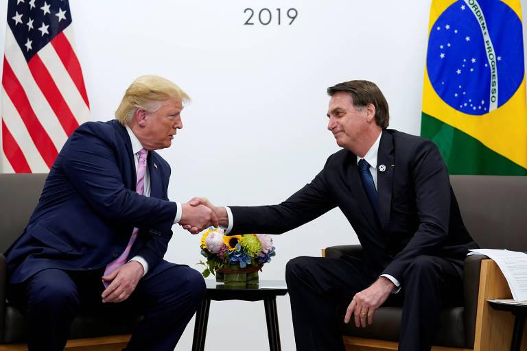 Os presidente de EUA, Donald Trump, e Brasil, Jair Bolsonaro, durante encontro bilateral durante o G20, no Japão