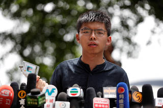 FILE PHOTO: Hong Kong democracy activist Joshua Wong speaks outside the Legislative Council building in Hong Kong