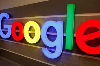 FILE PHOTO: An illuminated Google logo inside an office building in Zurich