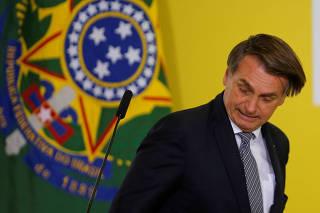 Brazil's President Jair Bolsonaro reacts during a ceremony at the Planalto Palace in Brasilia