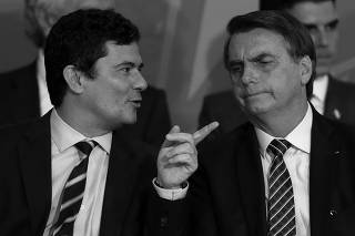 Sergio Moro e Jair Bolsonaro no lançamento do projeto Em Frente, Brasil, no Planalto