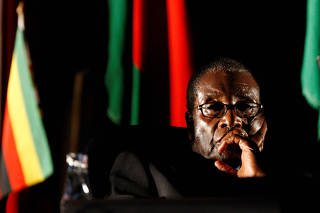 FILE PHOTO:  Zimbabwean President Robert Mugabe watches a video presentation during SADC in Johannesburg