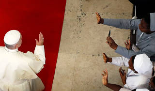 Pope Francis waves as he arrives at the Cathedral of Our Lady of the Immaculate Conception in Maputo