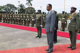 Eritrea's President Isaias Afwerki inspects honour guard on arrival at the State House in Entebbe