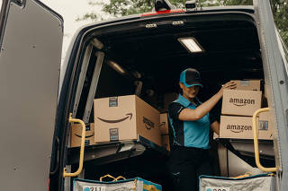 An example of the Amazon delivery truck and employee uniform, in Seattle.
