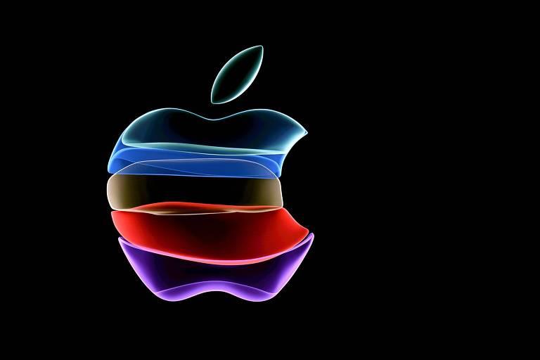 Logo da apple com contorno colorido projetado em uma tela preta