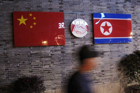 FILE PHOTO: Flags of China and North Korea are seen outside the closed Ryugyong Korean Restaurant in Ningbo, Zhejiang province, China, in this April 12, 2016 file photo. REUTERS/Joseph Campbell/File Photo ORG XMIT: FW1
