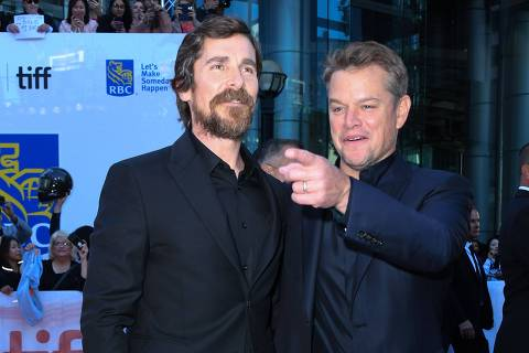 Actors Christian Bale (L) and Matt Damon attend the