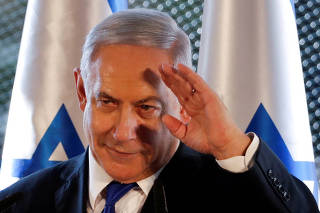 FILE PHOTO: Israeli Prime Minister Benjamin Netanyahu gestures as he speaks during a state memorial ceremony at the Tomb of the Patriarchs, a shrine holy to Jews and Muslims, in Hebron