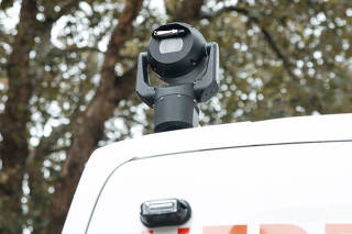 A facial recognition camera atop a police van at a rugby match in Cardiff, Wales, Aug. 31, 2019. (Francesca Jones/The New York Times)